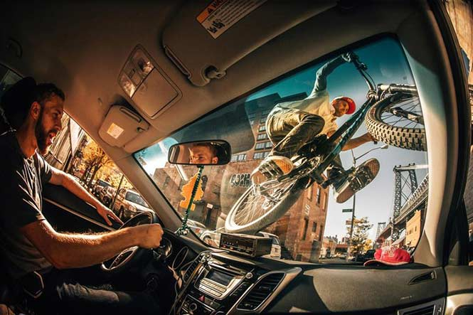 New Creativity: Ale Di Lullo, Italy for his fun shot of Aaron Chase riding his mountain bike on the windshield of a NYC cab.