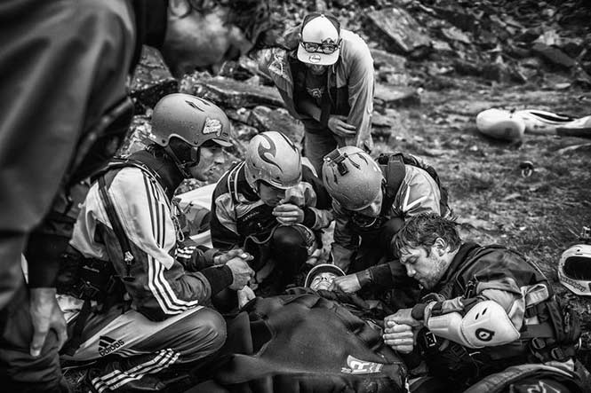 Spirit: Dean Treml, New Zealand for his image showing kayaker Josh Neilson being supported by fellow paddlers Barnaby Prees, Sam Sutton, Tim Pickering, Ben Brown, Jamie Sutton and Jaren Seiler after a bad landing off Matze's Drop, Storulfossen, Norway.