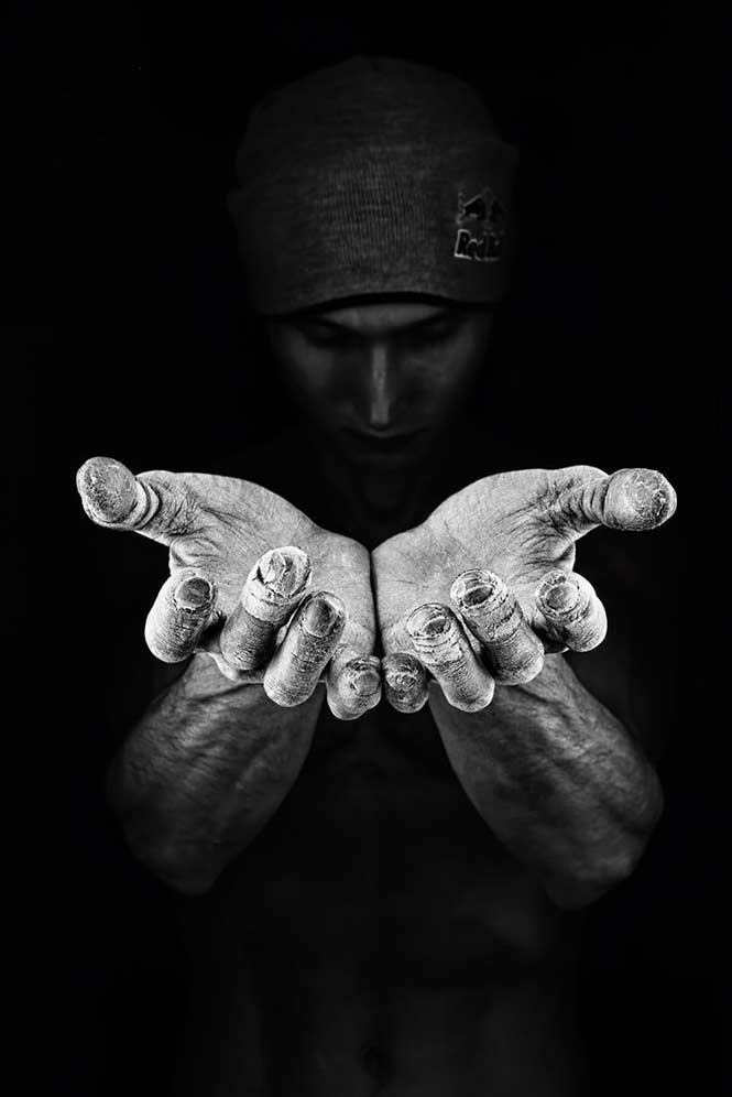 Close Up: Denis Klero, Russia with his black and white shot of climber Rustam Gelmanov showing his chalk-covered hands in Fontainebleu, France.
