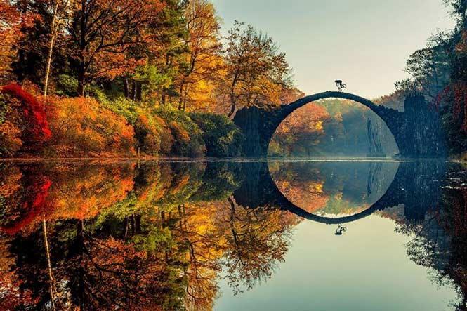 Masterpiece by Yodobashi: Lorenz Holder, Germany showing BMX rider Senad Grosic ride his bike over a bridge in an autumnal Gablenz, Germany.